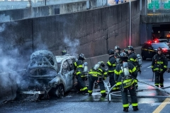 Firefighters Extinguish a car fire on the FDR drive at E. 63rd St. today.  There were no injuries