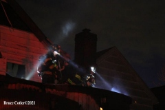 NEW YORK - Multi- Alarm residential fire guts home. Firefighters work to extinguish rapid moving fire. While Firefighters work on the fire Emergency Medical Service personnel wait to attend the injured.