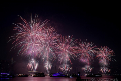 Fireworks light up the sky above the East River in New York City to celebrate Independence Day on July 4, 2021 in New York City. The fireworks were sponsored department store chain Macy's. (Photo by Andrew Schwartz)