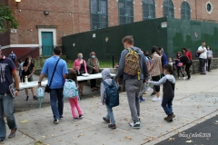 New York City starts the first day of school for Kindergarten students to eighth grade. On Thursday September 2, 2020 High School students will start classes.Teachers meet students outside of PS81x in the Riverdale section of the bronx they take the students temperature and then send them to meet other classmates and start the school day.