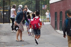 New York City starts the first day of school for Kindergarten students to eighth grade. On Thursday September 2, 2020 High School students will start classes.Teachers meet students outside of PS81x in the Riverdale section of the bronx they take the students temperature and then send them to meet other classmates and start the school day.Dawn Knecht Teacher welcomes students