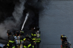 Firefighters work to put out a fast moving fire at Logan's Bus Company on Atlantic Avenue. (Photo by Lloyd Mitchell)