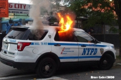 George Floyd Protest and Riot in Brooklyn. Protestors got angry and started to throw bottles and set on fire police vehicles and damaged others