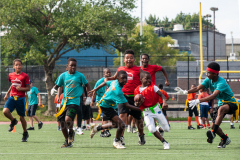 The summer heat didn't stop players to give it their all at the inaugural flag football tournament in honor of Det. Keith Williams. (Photo by Gabriele Holtermann)