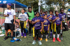 Players of the Rockaway Ravens listen to the Pledge of Allegiance at the inaugural flag football tournament in memory of Det. Keith Williams. (Photo by Gabriele Holtermann)