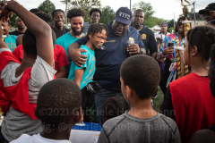NYPD Chief Jeffrey Maddrey embraces MVP Anthony Childs during the trophy ceremony of the inaugural flag footbal tournament in memory of fallen Det. Keith Williams. (Photo by Gabriele Holtermann)