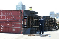 A tractor trailer flippied over and spilled 100's of gallons of fuel on the Brooklyn- Queens Expressway on Monday, April, 26th.