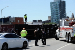 Big rig towers work to secure a tractor trailer that flipped over and sent 100's of gallons spilling onto the Brooklyn- Queens Expressway at Flushing Avenue.