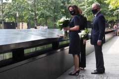 Kathy Hochul, Governor of New York, and Michael Bloomberg, founder of Bloomberg LP, right, lay flowers over the inscribed names of those who were killed in the 2001 and 1993 terrorist attacks at the edge of a memorial pool at the National September 11 Memorial & Museum in New York, U.S., on Wednesday, Sept. 8, 2021. This year marks the 20th anniversary of the attacks on the World Trade Center towers in New York