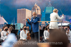 """Andrea Boccelli performs for the crowd attending the """"We Love NYC Homecoming Concert"""" on the Great Lawn in Central Park. (Photo by Gabriele Holtermann)"""