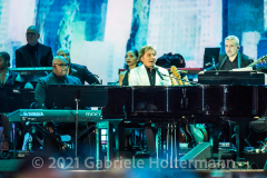 """Legend Barry Manilow gets a few tunes in before a storm halted the """"We Love NYC Homecoming Concert on the Great Lawn in Central Park. (Photo by Gabriele Holtermann)"""