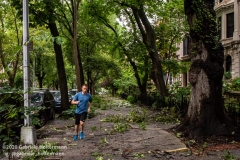 A jogger runs on the  3rd Street sidewalk in the Park Slope neighborhood of Brooklyn which is littered with debris after tropical storm Isaias hit  New York City on August 4, 2020. (Photo by Gabriele Holtermann/Sipa USA)