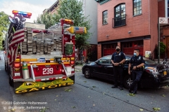 Two NYPD officers of the 78th Precinct on the scene of downed trees on 7th Street in the Park Slope neighborhood of Brooklyn as FDNY firefighters of Engine 239/Ladder 122 clear the scene. (Photo by Gabriele Holtermann/Sipa USA)