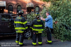 FDNY firefighters of Engine 239/Ladder 122 clear fallen trees on 7th Street in the Park Slope neighborhood of Brooklyn after tropical storm Isaias hit  New York City on August 4, 2020. (Photo by Gabriele Holtermann/Sipa USA)