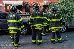 FDNY firefighters of Engine 239/Ladder 122 clear a fallen tree outside a home on 7th Street in the Park Slope neighborhood of Brooklyn after tropical storm Isaias hit  New York City on August 4, 2020. (Photo by Gabriele Holtermann/Sipa USA)