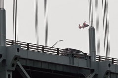 Tuesday, July 20, 2021 Verrazzano Bridge Staten Island, NY Photographs by Mary DiBiase Blaich  A woman was spotted jumping off the Brooklyn bound Verrazzano Bridge late Tuesday morning. Witnesses reported seeing her jump.  NYPD, FDNY and USCG searched the area under the bridge.  Video surveillance captured the incident.  A search was called to find the individual, including a US Coast Guard helicopter from Atlantic City who searched the area around the bridge. The victim's car was towed by MTBTA to their administration building as the search went on.
