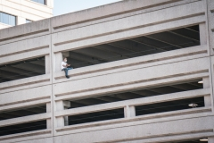 A man contemplates jumping from a parking structure in Jersey City, NJ.