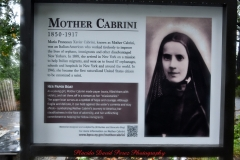 Mother Cabrini Statue at Battery Park South Cove location NYC. A rainy and foggy day. I even photographed a water spout on the Hudson River. It lasted less than a minute then disappeared.