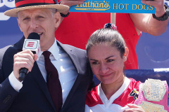 George Shea and Woman's hot dog eating champion Michelle Lesco during the 2021 Nathans Famous Fourth of July International Hot Dog Eating Contest at Coney Island on 04 July 2021 in New York City.