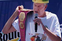 New York City Mayor Bill de Blasio holds up a champions belt during the 2021 Nathans Famous Fourth of July International Hot Dog Eating Contest .