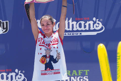 Woman's hot dog eating champion Michelle Lesco during the 2021 Nathans Famous Fourth of July International Hot Dog Eating Contest at Coney Island on 04 July 2021 in New York City.