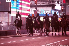 Mounted police from the New York City Police Department  in a mostly empty Times Square in New York City that remains empty due to Covid-19 restrictions.