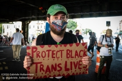 A Black Lives Matter supporter demands protecting black trans lives at a Blue Lives Matter rally in Brooklyn, New York, on July 12, 2020. (Photo by Gabriele Holtermann)