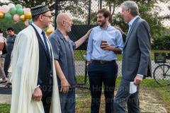 (R-L) State Senator Andrew Gounardes and NYC Mayor Bill de Blasio talk to members of the Islamic Society of Bay Ridge at the Eid-Al-Adha celebration in Bensonhurst, Brooklyn, NY,  on July 20, 2021. (Photo by Gabriele Holtermann)