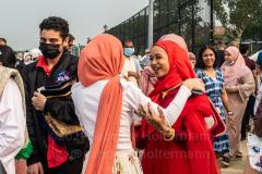 Members of the Islamic Society of Bay Ridge mingle after prayer at the Eid-Al-Adha celebration in Bensonhurst, Brooklyn, NY, on July 20, 2021. (Photo by Gabriele Holtermann)