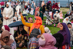 A woman takes a selfie at the Eid-Al-Adha celebration in Bensonhurst, Brooklyn, NY, on July 20, 2021. (Photo by Gabriele Holtermann)