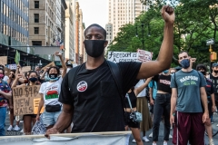Occupy City Hall protesters march past City Hall in New York City on June 23, 2020.  They demand defunding the NYPD by $1 billion and invest in education instead. (Photo by Gabriele Holtermann)