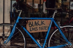 A bike belonging to an Occupy City Hall protester with a BLM sign is atttached to a fence across from the autonomous zone, or City Hall Park in New York City on June 29, 2020. The New York City Council is set to vote on the budget on Tuesday, June 30, 2020, and  Occupy City Hall demonstrators  demand that the council cut at least $1 billion from the NYPD budget. (Photo by Gabriele Holtermann)