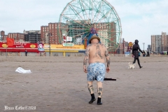 December 13,2020 Coney Island Polar Bear Club enjoys beautiful weather while people stroll the boardwalk and enjoy the sunny weather before the predicted snow storm to hit the East Coast on Wednesday.