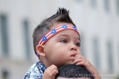 Little boy looks on during the 61st Annual National Puerto Rican Day Parade along 5th Avenue in New York on Sunday Jun 10, 2018  Photo by Enid B. Alvarez