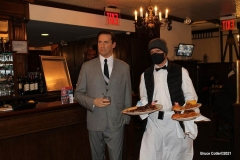 """New York- Iconic Steakhouse Peter Luger enlists Madame Tussauds wax figures for  """"safe"""" indoor dining experience during the corona virus. Celebrity wax figures fill seats for socially distancing dining. The figures are Audrey Hepburn, Jon Hamm,Jimmy Fallon, and Al Roker"""