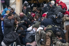 Washington, DC - January 6, 2021: Pro-Trump protesters confront police during rally around at Capitol building
