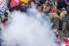 Washington, DC - January 6, 2021: Smoke rises after explosure police used pepper-spray ball gun against Pro-Trump protesters rally around Capitol building before they breached it and overrun it