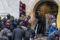 Washington, DC - January 6, 2021: Police defend Capitol building against Pro-Trump protesters by using papper spray