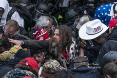 Washington, DC - January 6, 2021: Pro-Trump protester injured by tear gas during rally around at Capitol building when they tried to break in through front doors