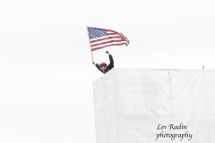 Washington, DC - January 6, 2021: Pro-Trump protester seen on top of bleeches at Capitol building built for Inauguration of 46th Presiden Joe Biden