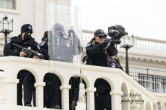 Washington, DC - January 6, 2021: Police seen preparing to shoot pepper-spray ball gun against pro-Trump protesters as they try to enter the Capitol building