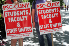 Member of the Professional Staff Congress the  college union that represents professors and college staff, protest in front of New York's City Hall.