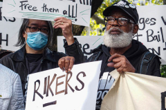 Demonstrators during a protest against Rikers Island Prison and facilities in front of City Hall, NYC, October 1, 2021. On September 22, 2021 the death of Stephan Khadu, 24, just a few days after Abdul Karim, became the 12th inmate to die at Rikers Island Prison in 2021. After various inquiries and investigations, activist groups such as:  Women Prison Coalition, HALT Solitary Confinement, Vocal New York and Jails Action Coalition  organized the protest to gather former inmates, family and supporters together, to demand answers from local authorities and political figures regarding the system of prison management, process of bail and incarceration of people who inevitably find themselves in prison without a conviction.  The protest moved from City Hall onto a Broadway intersection and blocked traffic up to a half a mile long for almost an hour.  (C) Bianca Otero, October 1, 2021