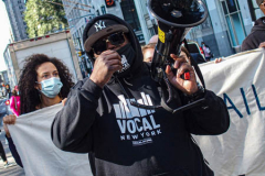 An activist speaks to the crowd during a protest against Rikers Island Prison and facilities in front of City Hall, NYC, October 1, 2021. On September 22, 2021 the death of Stephan Khadu, 24, just a few days after Abdul Karim, became the 12th inmate to die at Rikers Island Prison in 2021. After various inquiries and investigations, activist groups such as:  Women Prison Coalition, HALT Solitary Confinement, Vocal New York and Jails Action Coalition  organized the protest to gather former inmates, family and supporters together, to demand answers from local authorities and political figures regarding the system of prison management, process of bail and incarceration of people who inevitably find themselves in prison without a conviction.  The protest moved from City Hall onto a Broadway intersection and blocked traffic up to a half a mile long for almost an hour.  (C) Bianca Otero, October 1, 2021