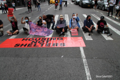 New York,   Housing Works inc. Advocacy group holds a rally and civil disobedience by laying down and blocking Broadway in front of City Hall. New York City Police Department officers arrested 9 people.