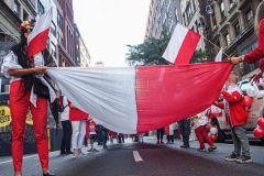 Polish-Americans gathered by the thousands in Midtown Manhattan, to celebrate the 84th Pulaski Day Parade, commemorating and honoring General Casimir Pulaski a Polish born aristocrat who is revered and remembered as both a Polish and an American Revolutionary War Hero, fighting for freedom in his homeland and adopted nation. Polish government and prominent local community figures came to celebrate the abundance of festivities and events that took place, marching up 5th ave from 36th to 53rd St.  This year, the theme spotlighted the 100th Birthday Anniversary of Pope John Paul II who was born in Wadowice, Poland.  (C) Bianca Otero, NYC, NY. October 3, 2021.