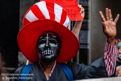 A man wears a death mask while a coalition of activists, educators, parents, and students protest to stop the in-person reopening of  New York City public schools amidst the COOVID-19 pandemic in New York City on August 3, 2020. (Photo by Gabriele Holtermann/Sipa USA)