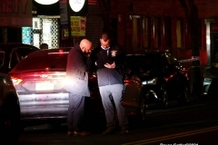 New York-  person shot on the conner of East 19th Street and Avenue M. in the Midwood section of Brooklyn. Police from the 70th precinct investigate the shooting. Red markers indicate where shell casing lay on the ground.