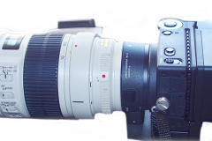 Sigma FP camera with the Sigma LVF-11 LCD Viewfinder for fp Mirrorless Digital Camera, and a Canon 70-200mm f2.8 L lens attached using the Mount converter MC-21