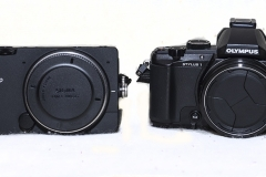 Sigma FP camera on the left next to a point and shoot camera. Almost the same size but no comparison